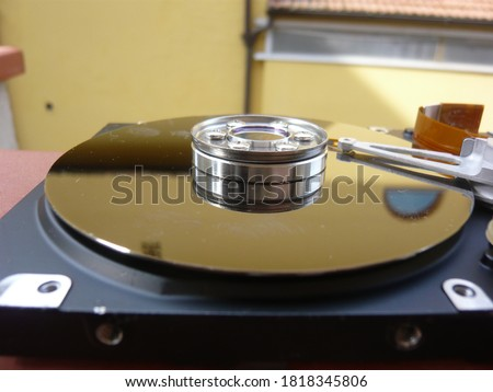Photo of  This is a Fujitsu disc drive with several views of the mechanical and electronic parts.