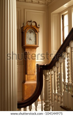This is a grandfather clock in a historic mansion.