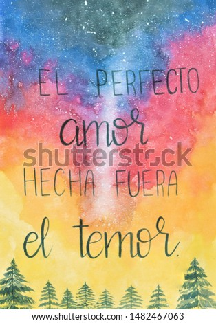 This is a handmade painting, using watercolors. It says: El perfectol amor hecha fuera el temor or Perfect love casts out fear. Foto stock ©