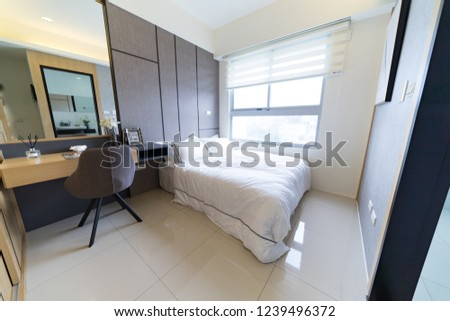 This is a newly decorated room. There are beds, bookcases, desks, chairs, wardrobes, etc. in the room. The bright room is suitable for living. #1239496372