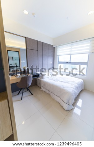 This is a newly decorated room. There are beds, bookcases, desks, chairs, wardrobes, etc. in the room. The bright room is suitable for living. #1239496405