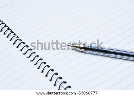 this is a notebook with a pen