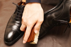 This is a photo of brushing leather shoes.