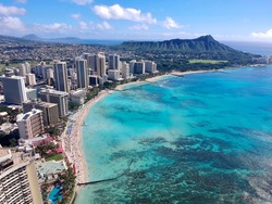 This is a photo taken of the Hawaiian coast line from a helicopter