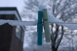 This is a photograph I took of the pegs on my washing line. The snow rested peacefully on top of them and along the side. I took this photo on a low aperture so that this would be in focus.