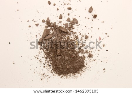 This is a photograph of deep Taupe powder Eyeshadow isolated on a White background #1462393103