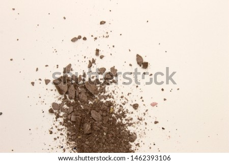 This is a photograph of deep Taupe powder Eyeshadow isolated on a White background #1462393106