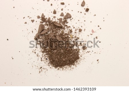 This is a photograph of deep Taupe powder Eyeshadow isolated on a White background #1462393109