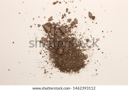 This is a photograph of deep Taupe powder Eyeshadow isolated on a White background #1462393112