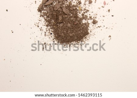 This is a photograph of deep Taupe powder Eyeshadow isolated on a White background #1462393115