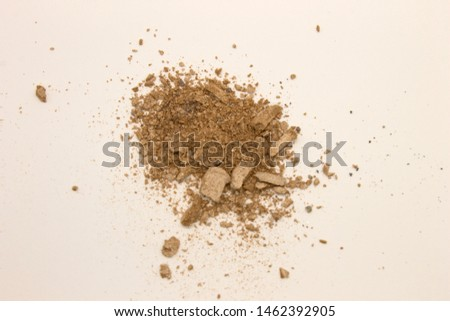 This is a photograph of pale Taupe powder Eyeshadow isolated on a White background #1462392905