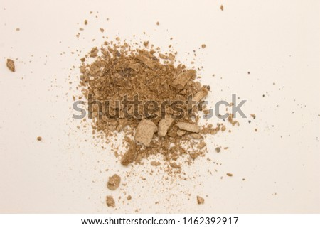 This is a photograph of pale Taupe powder Eyeshadow isolated on a White background #1462392917