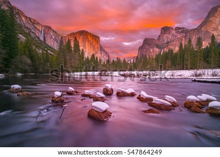 This is a photograph of Yosemite Valley at dusk with snow caps
