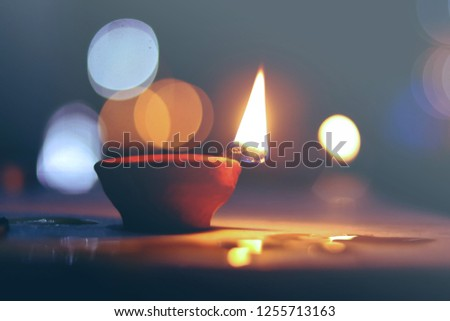 This is a pic of diya captured on the occuassion of diwali . This pic has a cool bokeh effect and can be used as backgound