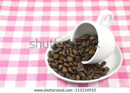 This is a picture of coffee beans and coffee cup.
