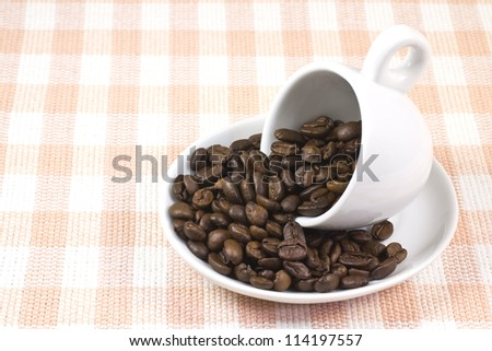 This is a picture of coffee beans and coffee cup. - stock photo