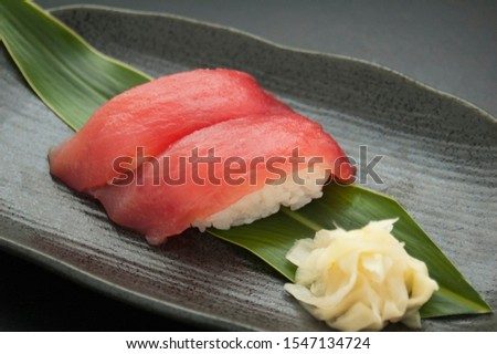 This is a picture of Japanese sushi. The ingredients for this shushi are Tuna.