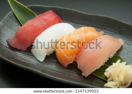 This is a picture of Japanese sushi. The ingredients for this shushi are Tuna, Squid, Salmon and Yellowtail.