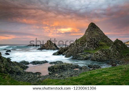 This is a picture of the rocky coast at Ballintoy on the Antrim Coast in Northern Ireland.  It was taken at sunset