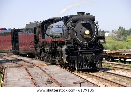 This is a restored steam locomotive on the tracks ready for an excursion.