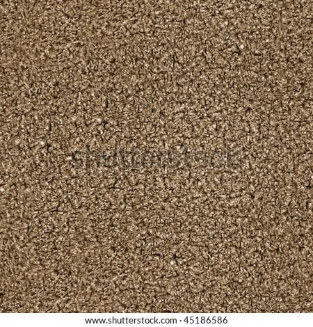 This is a seamless pattern texture background of corkboard. This is a photographic image. This also looks like brown carpet.