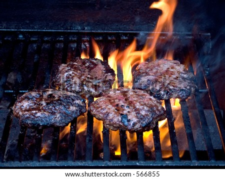 This is a shot of some burgers grilling.