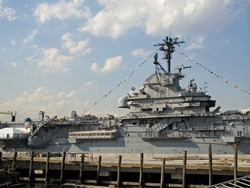 This is a shot of the bridge of a United States Navel aircraft carrier in port in Manhattan during Fleet week.