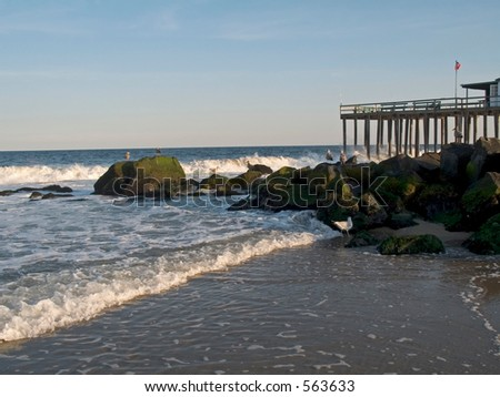 This is a shot of the fishing pier and surf along the beach at Ocean Grove NJ.