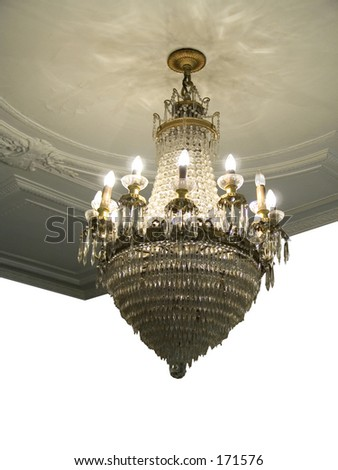 This is a silo drop-out white shot of an old chandelier and ceiling at an old theatre in New York.