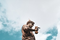 This is a very famous sculpute of the rome.The sculpture looks nice with backround the sky and the clouds.