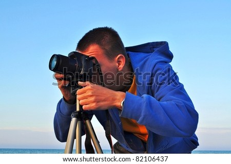 This is a view of photographer trying to take a picture