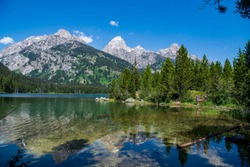 This is a view of Taggart Lake surrounded by the South Teton, Nez Perce, Middle Teton, Grand Teton, Mt. Owen and Teewinot peaks. Grand Teton National Park