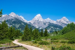 This is a view of the trail that leads to Taggart Lake. Shown here are the South Teton, Nez Perce, Middle Teton, Grand Teton, Mt. Owen and Teewinot peaks. Grand Teton National Park