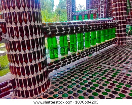 This is  amazing  million bottles temple. The part of building made withe bottles,  bottles in temple about 1,500,000 peaces.  it's the best way to reused the bottles  again.
