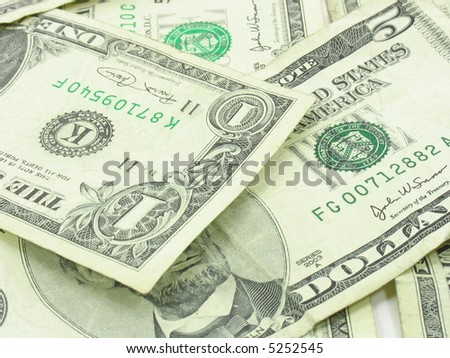 This is an abstract background of US money. Mostly featured is the five and the one dollar bills. Best if used as a background.