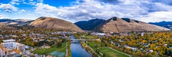 This is an aerial panoramic next the Higgins Street Bridge in Missoula, Montana on a beautiful fall day in Western Montana.  You can see the M on Mount Sentinel and L on Mount Jumbo.
