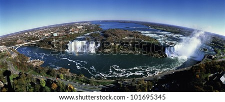 This is an aerial view of Rainbow Bridge, the American Falls and Horseshoe Falls.