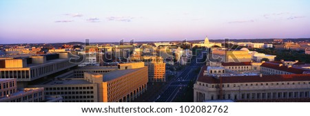 This is an aerial view of Washington, DC showing Pennsylvania Avenue to the U.S. Capitol at sunset.