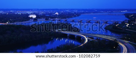 This is an aerial view of Washington, DC. The Potomac River runs through the center with the Key Bridge at right .