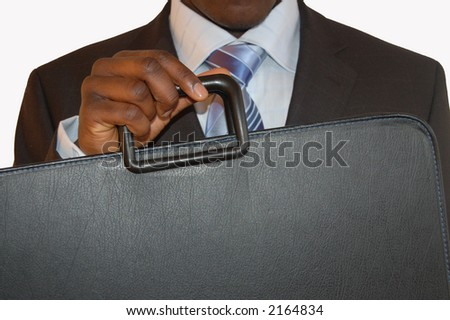 This is an image of a businessman with his portfolio or suitcase uplifted.