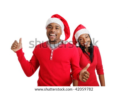 This is an image of a christmas couple laughing around.