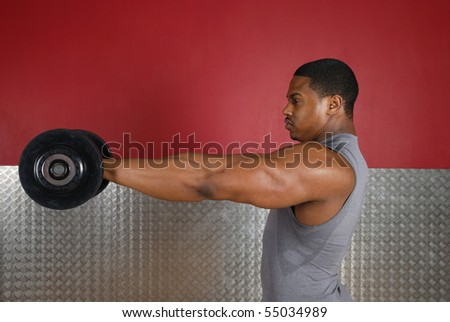 This is an image of a man lifting weights. - stock photo