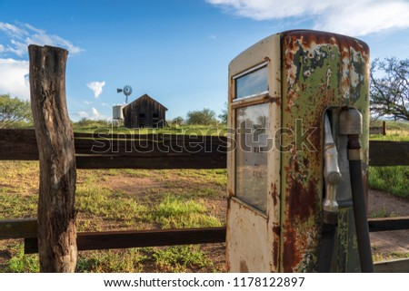 This is an image of and 1870s ranch in Southern Arizona. An old gas pump is in the foreground.