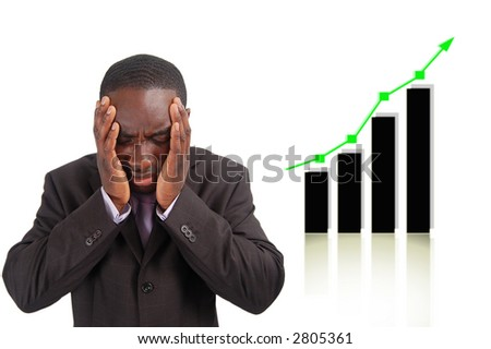 """This is an image of businessman frustrated by the rise in the graph which has affect his company sales. This can be used to represent themes such as """"Competitive Disadvantage"""" and """"Negative Impact"""". - stock photo"""