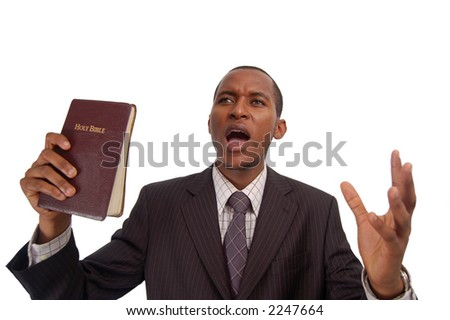 "This is an image of man holding a bible. This image can be used to represent ""sermon"", ""preaching"" etc..."