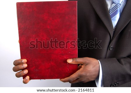 This is an image of man holding a portfolio.