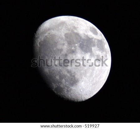this is an image of the moon in three quarter phase. it was taken with a 2000mm lens.