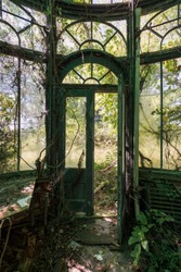 This is an interior view of a unique greenhouse /conservatory at the long abandoned and historic Dunnington Mansion in Farmville, Virginia.