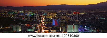 This is an older aerial view of the strip showing an overview of the whole Las Vegas area at sunset.