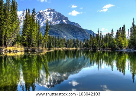 This is Cascade Mountain seen from the edge of the Bow River in Banff National Park, Alberta, Canada.